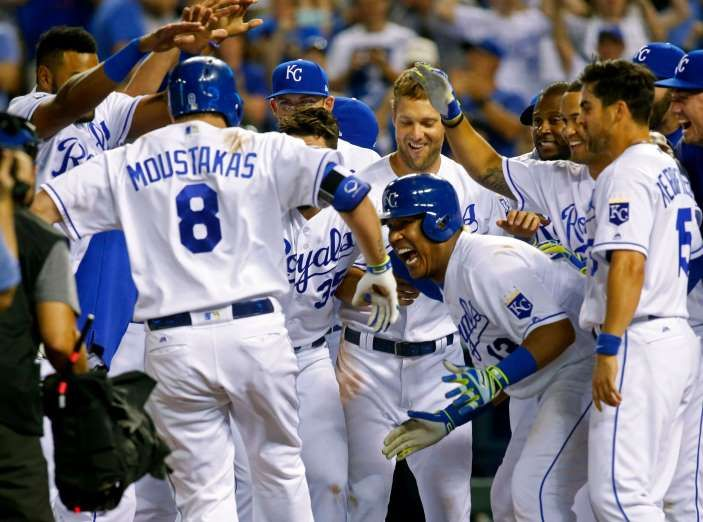 June 6: Kansas City Royals players wait to congratulate Mike Moustakas (8) at home plate after hitting a walk-off home run in a 9-7 win over the Houston Astros at Kauffman Stadium. The Royals' win ended the Astros' win streak at 11 games.