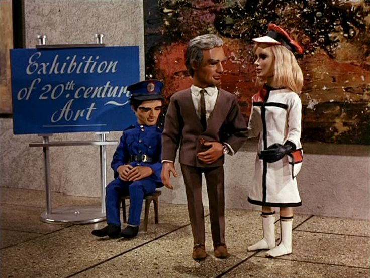 Thunderbirds TV show - Lady Penelope in Yves St Laurent (style) - also wearing a matching 'mod' hat - the series was made in 1966 and set in 2066. Lady Penelope is wearing 20th century style clothes to attend a retro 20th century art exhibition