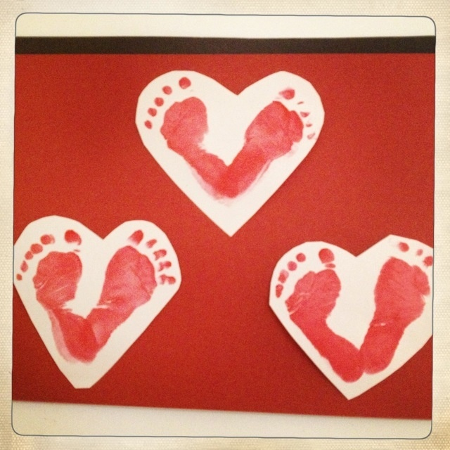 The teacher in a KinderCare infant classroom helped the students create hearts utilizing their footprints for Valentine's Day. Project ages: Older infant, Toddler, Preschool, or PreK.