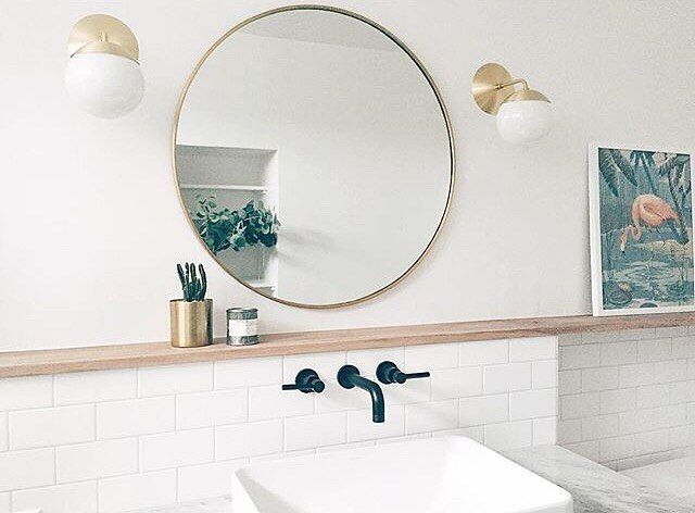 Reflect light and style with our Round Classic Framed Mirror, seen here in @sophiecarpenter's bathroom.  Crafted with a sleek metal frame and available in a variety of finishes, this timeless design will dress up any wall. Click link in profile for more inspiration on building a better bathroom & to shop this mirror. . . . #RejuveSpotted #myonepiece #bathroom #mirror #roundmirror