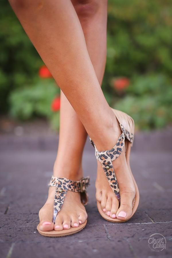 Take a walk on the wild side in these sassy leopard sandals! Leopard print, thong style sandals with strappy side detail and side buckle closure. Man-made materials. *Fit is true to size.