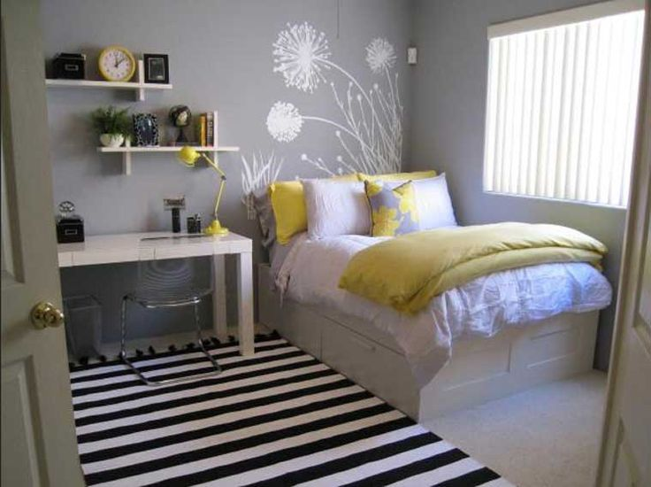Bedroom color ideas for teenagers with grey wall paint color with wall art design combined with white platform bed with storage and white study desk with glass chair equipped wall shelves