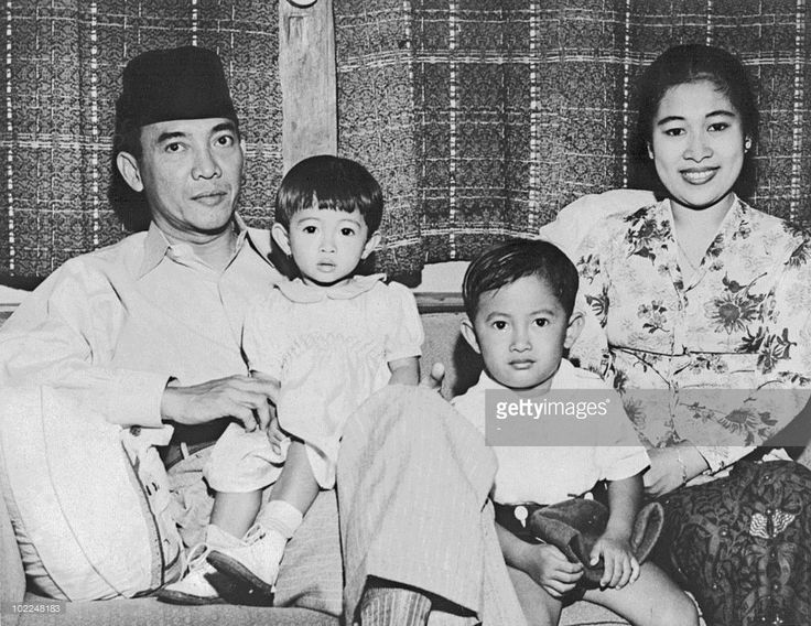 Indonesian President Achmed Sukarno (1902-70) poses with his family, his wife, their son Guntur and daughter Megawati at their home shortly after he was elected president in 1945. Sukarno was Indonesia's first president (1945-66) when Indonesia was granted independence in 1945.