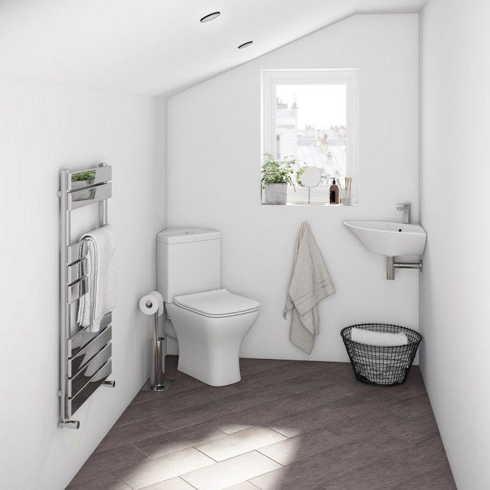Salle De Bain Avec Sol Gris Et Murs Blancs Wc Blanc Et Lavabo D
