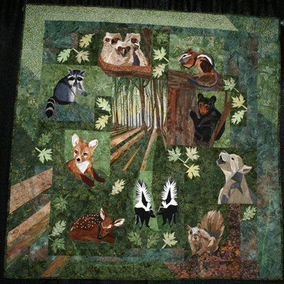 wildlife quilt. No pattern in evidence at website. Darn. But, I think many of these animals are from  Silver Linings Originals, north american collection. Maybe there was once a kit, or the quilter just pulled these together.