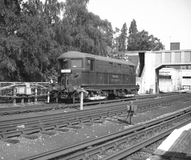 Electric locomotive at Acton Town  This shows an example of the class of 20 electric locomotives introduced by the Metropolitan Railway from 1922 onwards. Although they looked like new units, they were in fact drastic rebuilds of earlier stock, with much more powerful motors. They were used for many years before 1961 to haul Metropolitan trains from the City and Baker Street to (originally) Verney Junction and (later) Aylesbury, the electric loco being used as far as Rickmansworth.