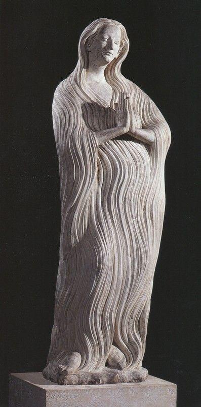 Merveilleuse statue (1311-1313) de Marie-Madeleine de l'église Notre-Dame, d'Écouis (Eure), vêtue simplement et chichement de sa seule chevelure
