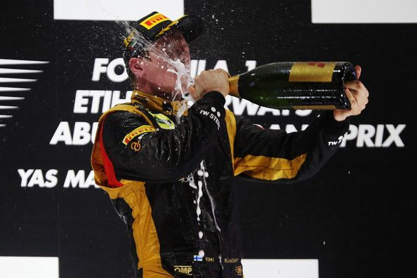 Kimi Raikkonen of Finland and Lotus celebrates on the podium after winning the Abu Dhabi Formula One Grand Prix