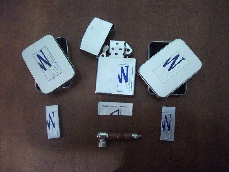 Lotto di 2 accendini a fiamma+scatole in metallo+1 zippo grande+1 pipa in legno
