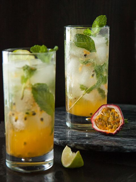 Passionfruit Mojito (ingredients per drink)  1 passion fruit 1 1/2 oz. white rum 1 oz. mint simple syrup (instructions below) 1/2 lime, juiced 1/2 cup club soda, to taste ice lime wedges and fresh mint leaves, for garnish  For the mint simple syrup: 1 cup water 1 cup sugar 8-10 mint leaves