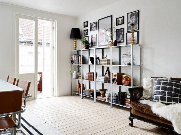 White bookshelf in living room with brown loveseat
