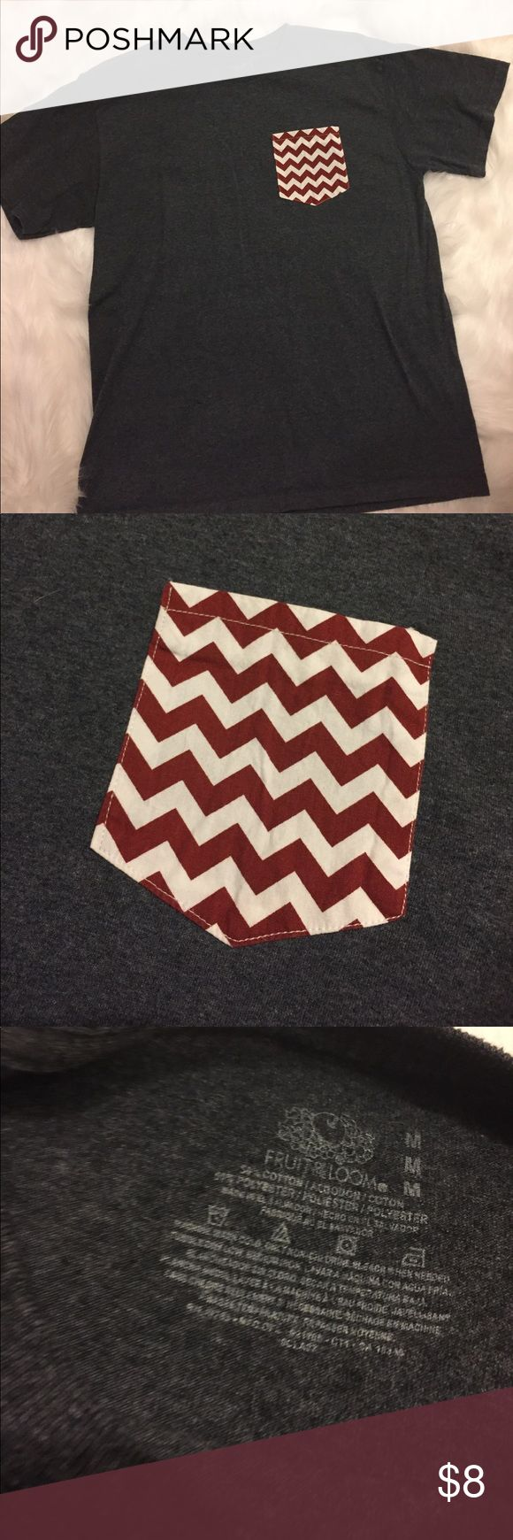 "Cute Pocket Tee Charcoal gray with chevron print pocket! Worn a couple of times! Size medium...length 27"". Across bust 21"" Tops Tees - Short Sleeve"