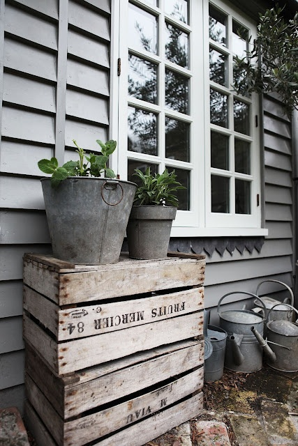 Gorgeous grey weatherboard, tin pots and watering cans, weathered boxes.