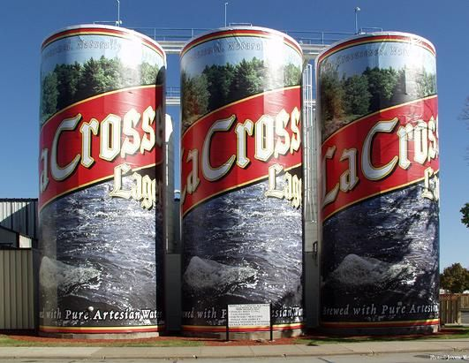 In  La Crosse, Wis., visitors can find the world's largest six pack. The storage tanks for a local brewery have been skillfully pained over the years to represent beer cans. They tanks hold enough beer to fill 7,340,976 cans of beer, or enough booze to provide a person a six pack a day for 3,351 years.