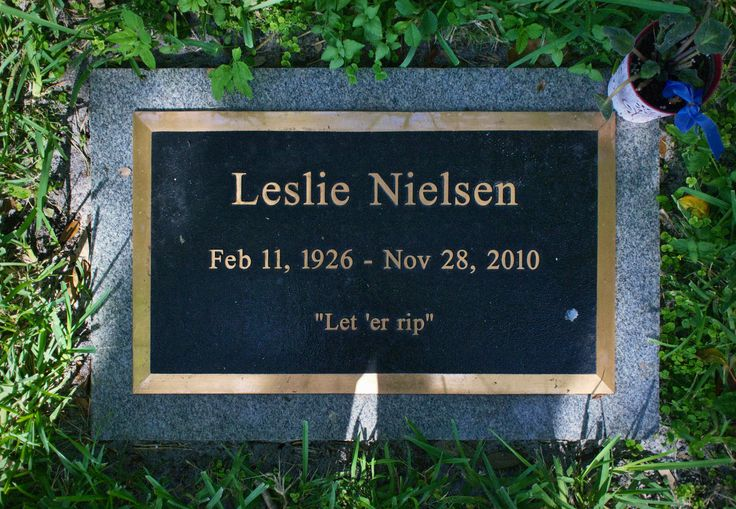 """Leslie Nielsen's Headstone in Fort Lauderdale's Evergreen Cemetery. As a final bit of humor, Nielsen chose """"Let 'er rip"""" as his epitaph."""