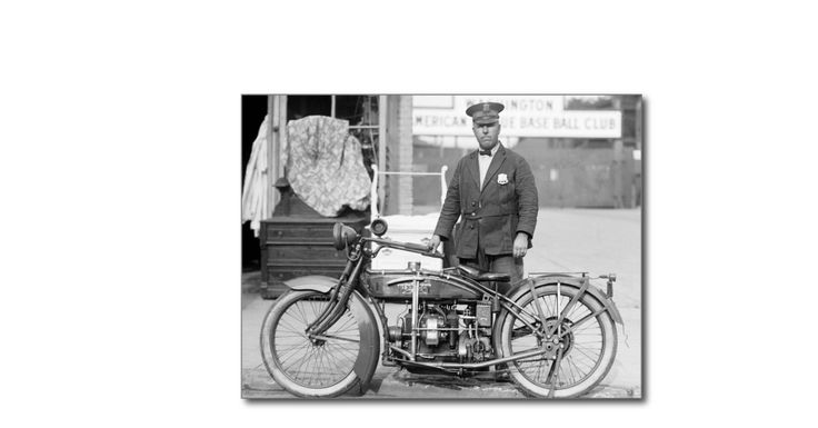 Policeman with antique Henderson motorcycle in front of Washington (Senators) American League Base Ball Club sign, 1922.