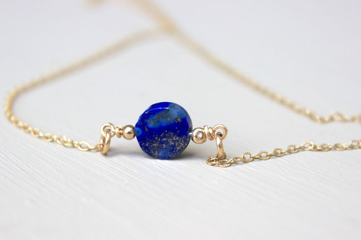 A beautiful lapis lazuli bead suspended from a 14K gold fill chain and accented with 14K gold fill beads. This necklace features a spring ring clasp. All metal hardware is 14K gold filled. A necklace