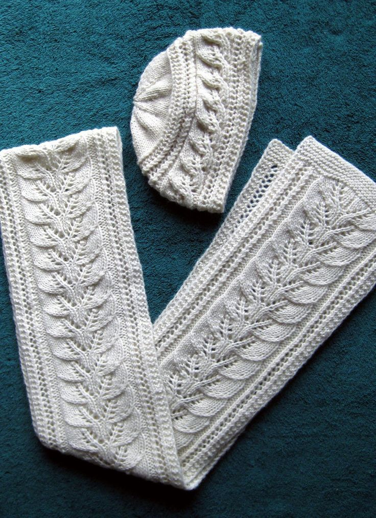 Free Knitting Pattern for Column of Leaves Hat and Scarf Set - Matching lace hat and scarf pattern also has a video tutorial. Designed by Brooke Nelson. Pictured project byhill53gv