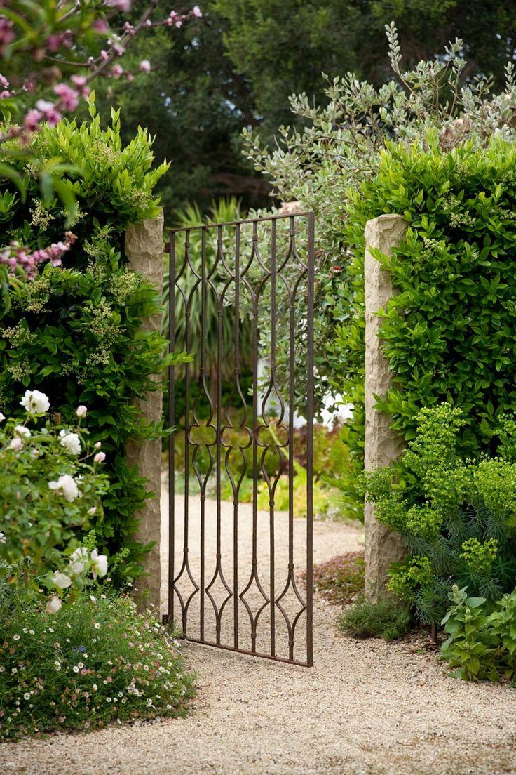 Gorgeous French country garden and iron gate. #garden #gate #frenchcountry #europeanfarmhouse