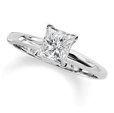 Princess-cut solitaire!  a smaller rock though (I mean, let's be practical here - this would catch on everything)