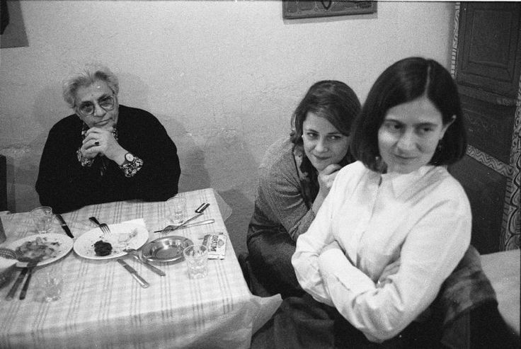 Nikos Economopoulos. Greek folk singer and researcher Domna SAMIOU in a tavern with friends.