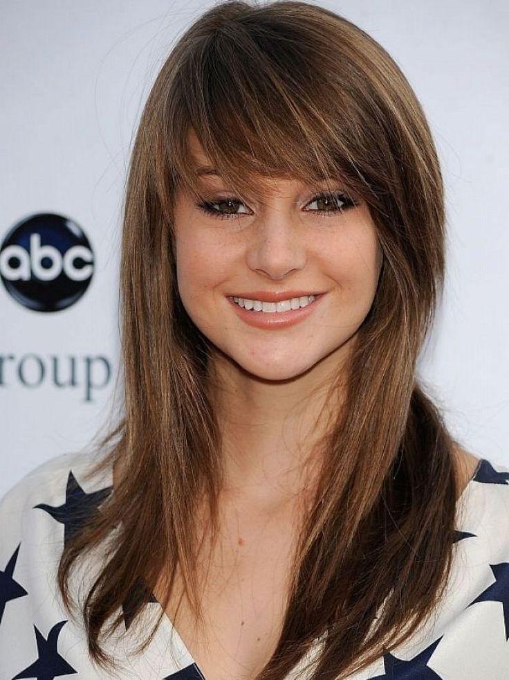 Long light brown hair with full bangs