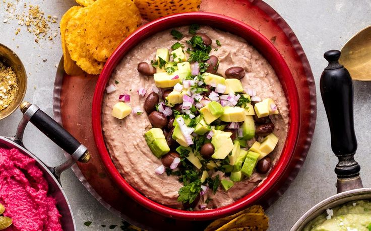 This tasty black bean hummus dip recipe is packed full of vegan protein. Serve with our avocado salsa and corn chips for a filling and healthy snack.