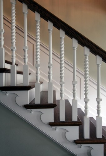 Gorgeous turned balusters on this traditional staircase by Hull Historical, Fort Worth