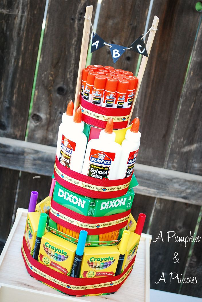 School Supply Cake- teach your little ones about giving back to the community.