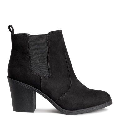 Black. Ankle boots in imitation suede with decorative seams, elastic gores in the sides, a loop at the back, satin linings, imitation leather insoles and