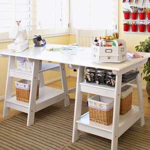 I have always loved this desk for a scrapbooking/crafting table...if only it could be made taller, to stand at while working.