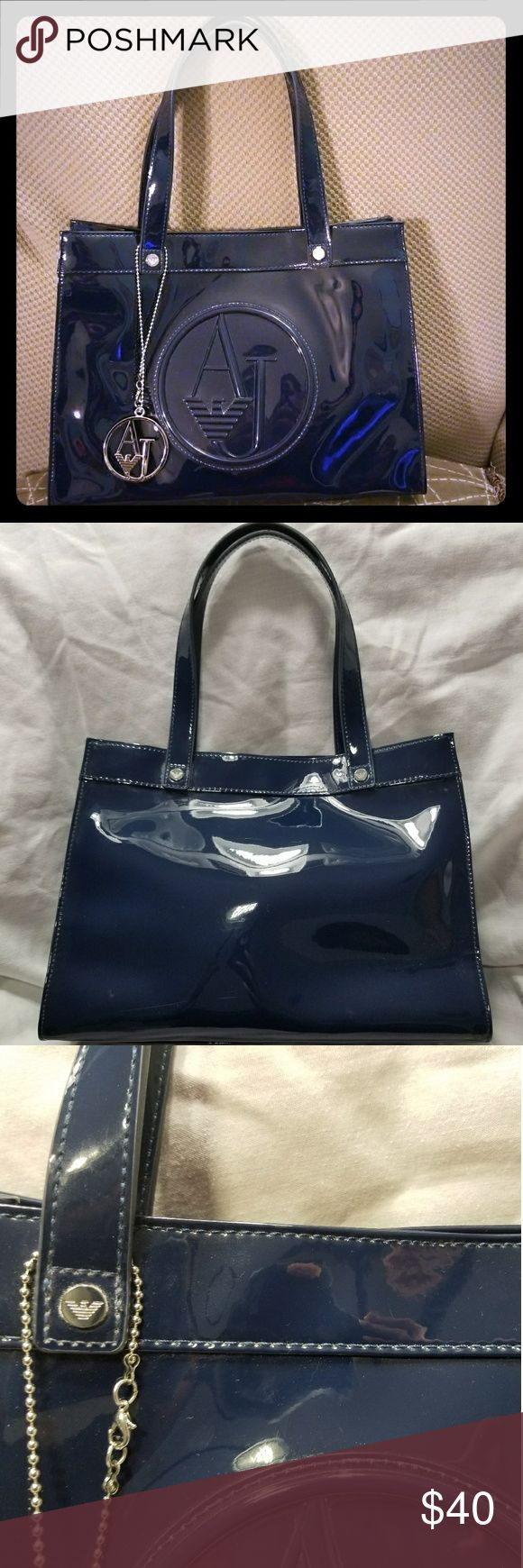 Armani Jeans Blue Handbag / Purse Like New! Armani Jeans Blue handbag. 100% PVC. Solid blue color. Internal pocket. Intact lining. Only a slight scuff on the lower left corner of the back of the bag (see pictures). MSRP $220. Armani Jeans Bags Totes