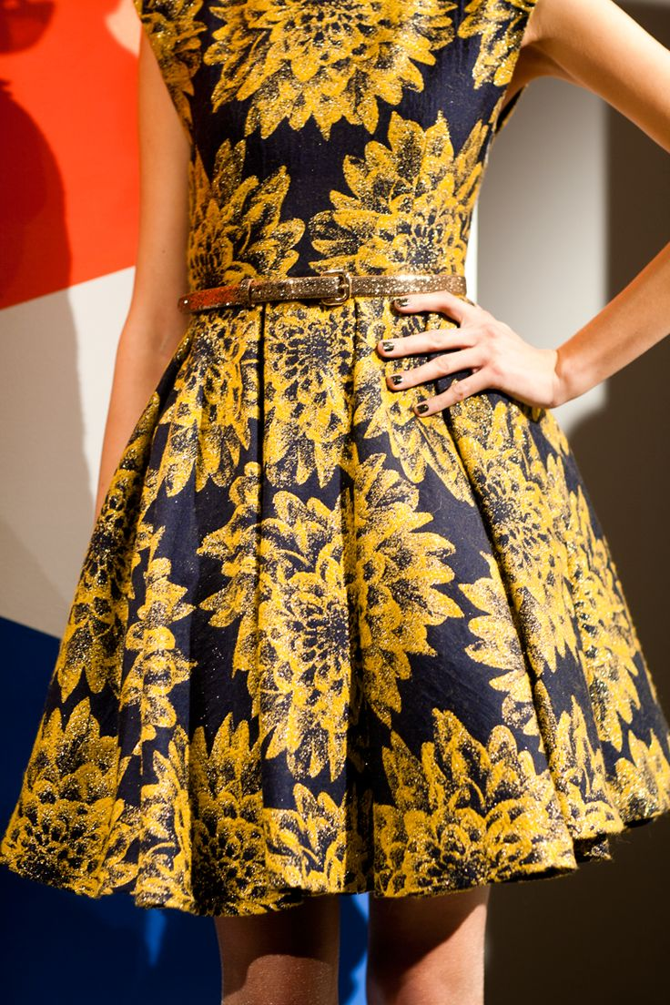 Flare box pleat dress in an amazing navy and gold print!