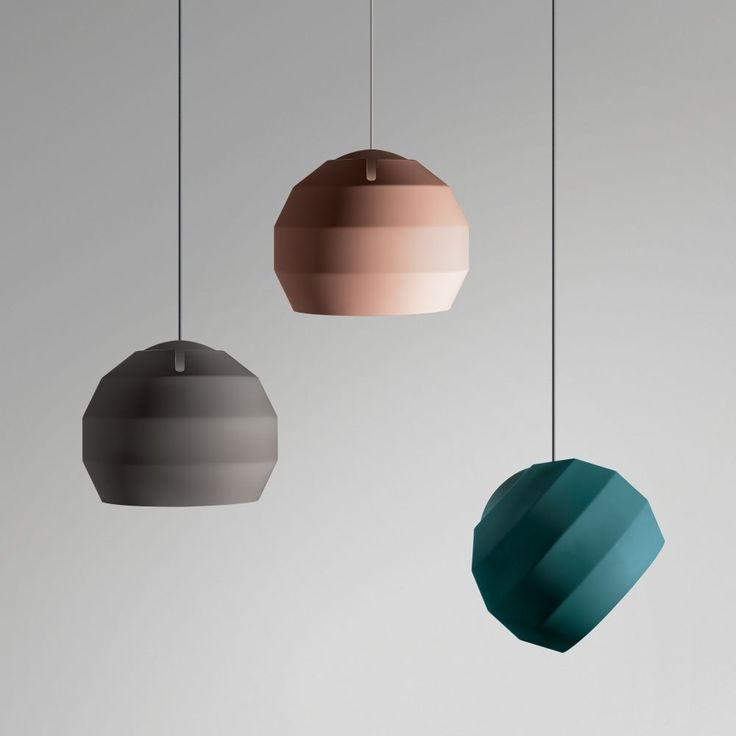 Handmade in the UK by Vitamin, the Pitch Pendant lamp comprises a banded spun aluminium shade poised on an internal dome, the outer shade can be posed to guide light in any direction.