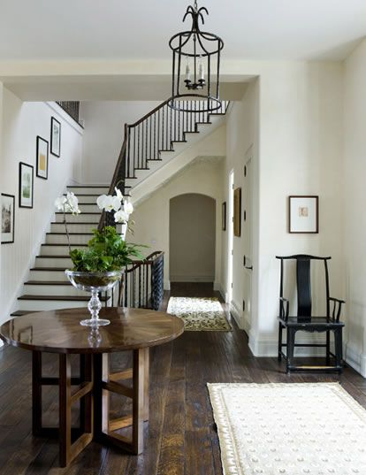 Foyer. l think this is my new favorite designer! Love color, hardwood, furniture, art...