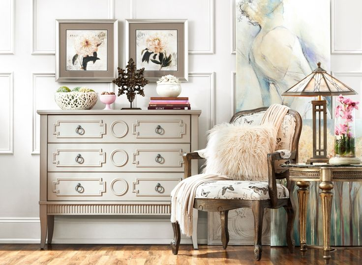 Chic and stunning, this Adrian accent chest will catch your eye no matter where in your home you place it. This gorgeous piece features an antique pewter hardware finish, a gray wood finish and lovely carved accents for a blend of classic and contemporary elements.