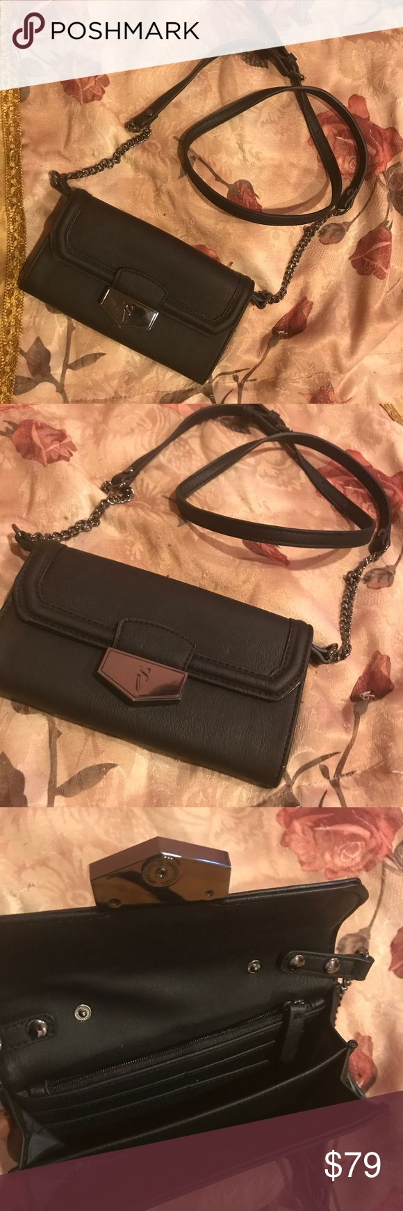 "Black Simply Vera WOC Like only worn once BNWT, ""Simply Vera"" by the Vera Wang collection wallet on a chain  ....(The more you buy, the more I lower my prices so bundle & save!!) Simply Vera Vera Wang Bags"