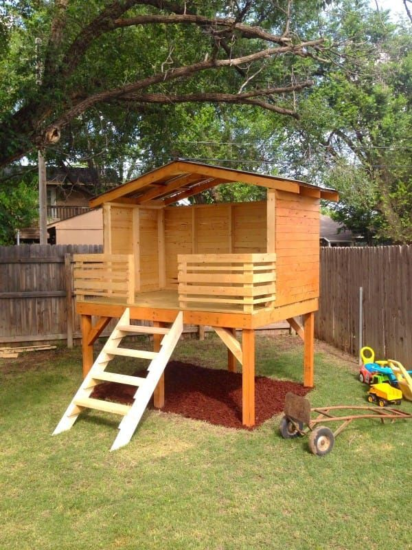 After adding some red mulch and a warm stain, the little fort was nearly complete.