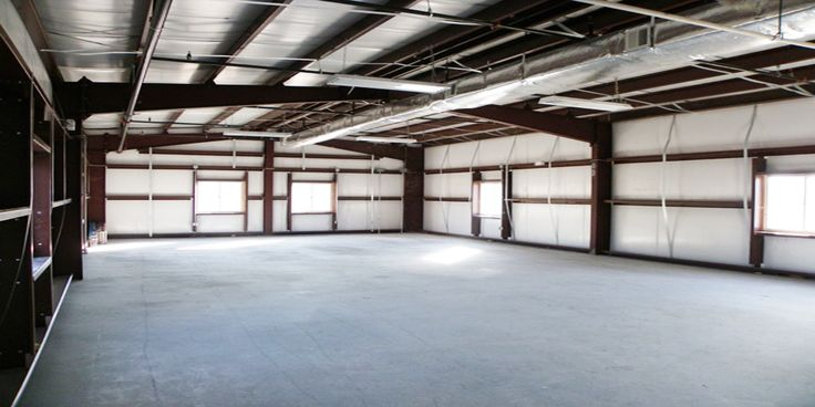 the interior of a general steel garage showing clear span