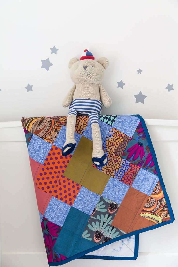 Would it be nice if your child could snuggle up in this gorgeous toddler quilt? Fabrics are by Kaffe Fassett and the back is hand dyed by RomorDesigns