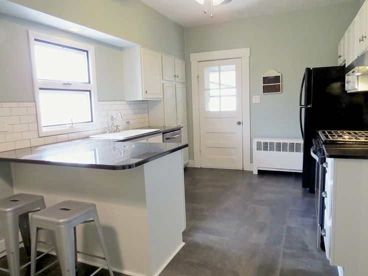 Kitchen transformation in a pre-1900 Victorian in Xenia, OH.  Granite counters, gas cooktop, white subway tile backsplash.