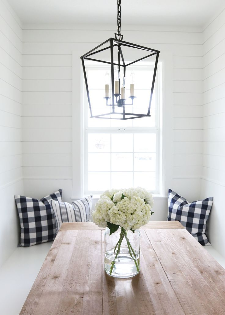 The perfectly simple kitchen nook dressed up with white hyrdangea and black/white checkered pillows.