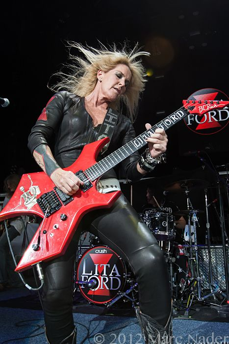 "Lita Ford: British born, reared on the L.A. scene, and lead guitarist of the female breakthrough band of the late 70's, the Runaways, the same band led by Joan Jett. Her solo career after the band's breakup flourished under the management of Sharon Osbourne (Ozzy's wife and music producer-thus leading to the get together on the hit single ""Close My Eyes Forever""). Still rockin' and about to celebrate her 55th birthday this September. Photograph-(C) 2012, By Marc Nader"