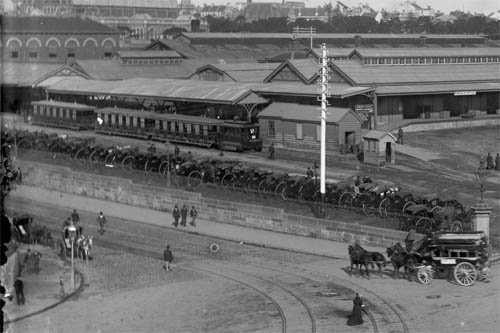 The station in this photo is the 'old' Redfern Railway Station which was demolished to make way for the opening of Central Station in 1960. It used to be located at end of Devonshire Street, 200 meters south of current Central Station. Confusingly this 'Redfern Station' is not the same as the current Redfern Railway Station which was transferred to Lawson Street when Central Station opened in 1906. The Redfern Station we know today was formerly known as Eveleigh Station.