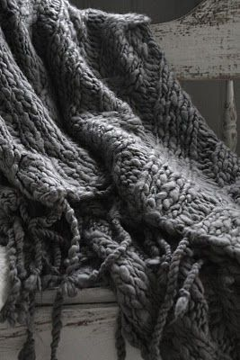 This just may inspire me to knit a big, chunky gray blanket for next Fall :)