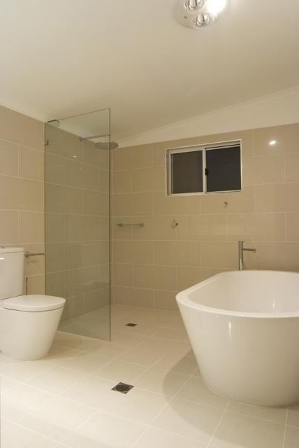 beige tiles, white vanity
