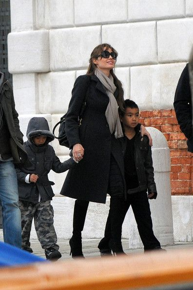 Sweet Angelina Jolie...  Fashionable Hairstyles ...   Jolie and Pitt have three adopted children and three biological children.