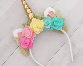 Diadema cuerno de unicornio en rosa flores cuerno espiral
