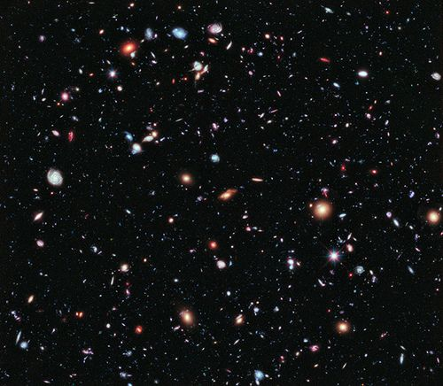 This image is the combined total of over 2000 separate images, and the total exposure is a whopping two million seconds, or 23 days! It's based on the original Hubble Ultra Deep Field, with new observations added in since the originals were done. It shows over 5500 galaxies - nearly everything you see in the picture is a galaxy, an island universe of billions of stars. Only a handful of individual stars in the foreground of our own galaxy can be seen.