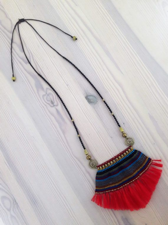 Welcome to Bohemian Style Statement Pieces...  You're looking at a the oh-so-bold red fringe pendant necklace, complete with rainbow 'wave' macrame woven around gold brass wire, with gold brass beads. Totally adjustable in length to wear to suit your style.    www.bohemianstyleshopl.etsy.com